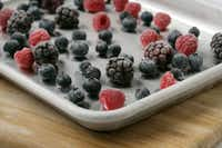 Freeze berries on a cookie sheet. Make sure they're not touching, so you end up with individual frozen berries. Store them in a freezer bag.