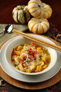 BUTTERNUT SQUASH CHOWDER WITH PUMPKIN RAVIOLI - This hearty version with pumpkin ravioli celebrates the fall season.Evans Caglage