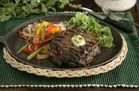 A beautifully grilled ribeye steak.Evans Caglage / Staff photographer