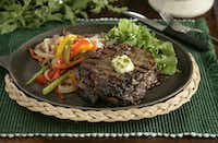 A beautifully grilled ribeye steak.(Evans Caglage / Staff photographer)