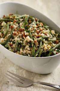 Satisfy your Parisian palate with haricots verts, rice and toasted almonds, served cold. Read the story for the recipe.(Evans Caglage - Staff Photographer)