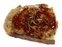Almond Butter, Cherry Brandy Jam and Lemon Zest on Rosemary Bread from Village Baking Co.(Evans Caglage - Staff Photographer)