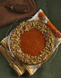 Pump up the traditional pumpkin pie with  Gingersnap Pumpkin Pie With Candied Pumpkin Seeds.