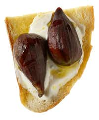 Goat Cheese, Figs and Olive Oil on Sourdough Bread from Central Market(Evans Caglage - Staff Photographer)