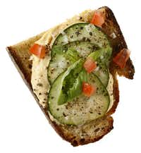 Hummus, Cucumber, Basil, Tomato, Sea Salt and Black Pepper on Rye Bread from Village Baking Co.(Evans Caglage - Staff Photographer)