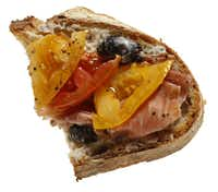 Goat Cheese, Prosciutto, Tomato and Black Pepper on Olive Bread from Central Market(Evans Caglage - Staff Photographer)