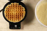 Scoop the desired amount of batter onto a greased and warmed waffle iron and cook until golden brown.(Vernon Bryant - Staff Photographer)