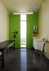 Legacy ER exam rooms in Frisco have lime green walls for a visual boost.( Michael Ainsworth  -  Staff Photographer )
