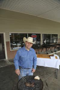 Matt Hamilton demonstrates how to cook ribeye steaks in front of his shop in McKinney Tuesday June 4, 2013. His shop, Local Yocal Farm to Market, raises and butchers their own meat .Ron Baselice - Staff Photographer