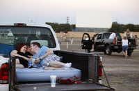 Rachel Leigh Marek and Andrew Shepherd wait for their movie to start at the Galaxy Drive-In in Ennis, Texas on Wednesday, August 6, 2014.Brad Loper  -  Staff Photographer