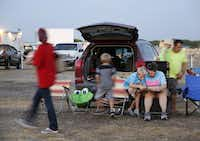 Donnelle Cuellar reads with her son, Jeremiah, 9, as the family waits for their movie to start at the Galaxy Drive-In in Ennis, Texas on Wednesday, August 6, 2014.( Brad Loper  -  Staff Photographer )