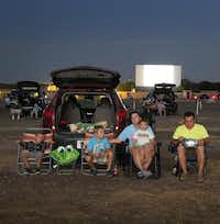 The Cuellar family including (L-R) Cole, Jeremiah, Donnelle , Kamdon and Jeremy watch Guardians of the Galaxy at the Galaxy Drive-In in Ennis, Texas on Wednesday, August 6, 2014.( Brad Loper  -  Staff Photographer )