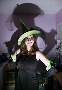 Elena Atiles, 16, wears a witch hat and gloves that were part of the Elphaba costume she wore for Comic-Con.( Ben Torres  -  Special Contributor )
