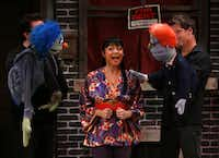 James Chandler, left, as Nicky, Olivia de Guzman Emile, center, as Christmas Eve, and Michael Robinson, right as Rod, perform the opening number of Avenue Q on January 11, 2014 at Stage West Theatre in Fort Worth(Sarah Hoffman - Staff Photographer)