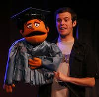 Matt Purvis performs as Princeton during the opening number of Avenue Q on January 11, 2014 at Stage West Theatre in Fort Worth(Sarah Hoffman - Staff Photographer)