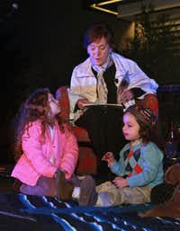 "Joy Mankoff reads ""Bagels from Benny""  by Aubrey Davis to children, including Jordyn  Denn, 5, and  Xander Denn, 3, at a service that concludes the Jewish Shabbat."