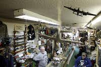 (left to right) The Recon Militaria store owner D.J. Goodwin sits behind the counter while talking with his wife, Lolita Goodwin and friend, Don Stroud in his store that specializes in selling collectible military gear and surplus in Dallas on February 13, 2013.