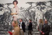 Guests walk past portraits of Cindy Sherman during a preview of the photographer's exhibit at the Dallas Museum of Art.