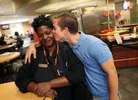 "Cafeteria employee Tamerlyn Holmes, 37, also known as Momma T, receives a kiss from her new friend SMU freshman Thomas King, 19, during an interview on Sept. 17, 2012, at the Umphrey Lee cafeteria on the campus of SMU. King met Ms. Holmes in mid-August at the start of school semester and have been meeting every week since. King says Holmes' freshly made omelets are made with ""lots of love."""