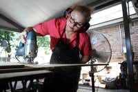 """""""The Sign Lady"""" Cindy Villela, cuts portions of a light-weight wood which will be used for signs at her home workshop, on June 20, 2012 in Richardson. Villela started carpentry at age 10 and now has a successful 15-year-old business making handmade figural spirit signs for area schools."""