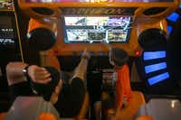 Bayren Bryce, left, and Alex Bryce, 10, of Plano, TX. choose a map on the virtual roller coaster Typhoon at Adventure Landing in Dallas, TX. on Sept. 27, 2012. (Christian Randolph/The Dallas Morning News)