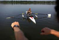 John Cage is instructed on technique during the Adaptive Rowing program at White Rock Boathouse on White Rock Lake on July 31, 2013 in Dallas. Cage was paralyzed last year as a result of West Nile virus. The program trains people who have a physical disability to row. The participants learn adaptive erging on land first followed by sculling on the water.