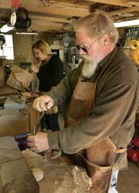 Greg White and his daughter Tracey Nelson in their Watauga workshop where they build small decorative barns from reclaimed lumber, photographed November 28, 2012.