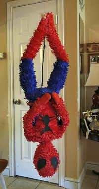A custom designed Spider-Man piñata hangs around Maria Barrera's house, awaiting pick-up.( Evans Caglage  -  Staff Photographer )