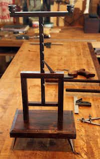 A spare candelabrum is in the works at Phillips' workshop.