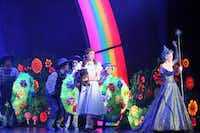 Dorothy (Danielle Wade, left) and Glinda (Robin Evan Willis, right) perform in opening night of Dallas Summer Musicals The Wizard of Oz at Music Hall at Fair Park in Dallas, Texas, Wednesday, March 19, 2014.(Allison Slomowitz - Special Contributor)