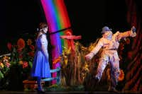 Dorothy (Danielle Wade, left) and Scarecrow (Jamie McKnight, right) perform in opening night of Dallas Summer Musicals The Wizard of Oz at Music Hall at Fair Park in Dallas, Texas, Wednesday, March 19, 2014.(Allison Slomowitz - Special Contributor)