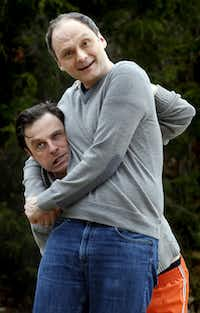"""J. Anthony Crane's Oscar Madison is put in a headlock by Michael Mastro's Felix Ungar during a performance of """"The Odd Couple"""" at Dallas Theater Center."""