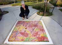 "In this 2009 file photo, artist Karen Blessen stands by a sidewalk mosaic in the plaza next to the Baylor DART station. Blessen designed the art elements of the station and also the ""sense"" paths in the plaza adjacent to the station. The panels stand for the five senses."