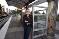 Dallas artist Karen Blessen  stands at the Baylor DART station at the time of its opening in 2009.