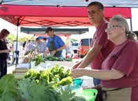 Steve and Cat Elliott of Elliott Grows, sell lettuce and herbs at the Coppell Farmers Market in Coppell, Texas.