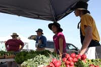 Weathertop Natural Produce features fresh vegetables, shown at the Coppell Farmers Market in Coppell, Texas.