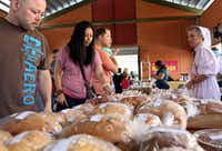 Rebecca Moore, right, of The Country Store Bakery sells breads and pies, as Israel Zapata, left, looks at the varieties in Grand Prairie, Texas on Saturday, April 13, 2013.(Allison Slomowitz - Special Contributor)