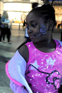 Serenity, 7, flaunts her freshly painted face at the annual Spring Block Party.(Alexandra Olivia - Special Contributor)