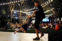 Derek and daughter Brooklyn Reaves dance to old-school tunes at the Nasher on Friday night at the annual Spring Block Party in the Dallas Arts District.(Alexandra Olivia - Special Contributor)
