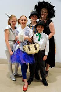 Not many attendees dressed as the theme of the evening, The Wizard Of Oz, but the Carr family put their Halloween costumes to use: Jocelyn Moody as the Tin Man, Elisabeth Carr as Dorothy, Andrew Carr as the Scarecrow, Zachary Carr as the Wizard, and mother Caroline Carr as the Wicked Witch of the West.(Alexandra Olivia - Special Contributor)