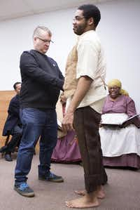 MBS Productions'  Mark-Brian Sonna (left) adds to Kwame Lilly's costume during a rehearsal for  Slave Letters,  which is based on real  letters written by slaves in the U.S.(Andrew Buckley - Special Contributor)