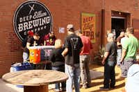 Guests line up to sample the two of the offerings at theone-year anniversary of the Deep Ellum Brewing Co Saturday, November17th, 2012, in Dallas