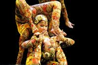 """Contortionists perform on the opening night of Cirque du Soleil's """"Kooza"""" on Wednesday, Sept.  19, 2012 in Dallas."""