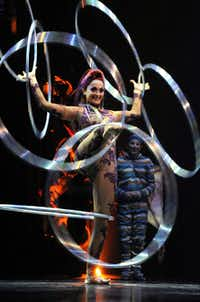 """A hoops manipulation performance on the opening night of Cirque du Soleil's """"Kooza"""" on Wednesday, Sept.  19, 2012 in Dallas."""