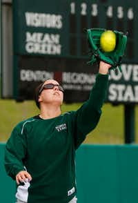 UNT outfielder Jen Beardsley of Flower Mound demonstrates the incorrect way to catch a fly ball. But she did remember her sunglasses.