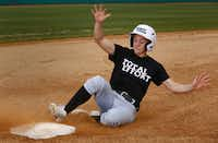 UNT second baseman Brooke Foster demonstrates the proper way to slide into the base.