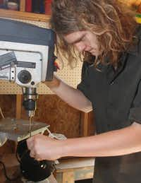 Gavin Pugh, 16, uses a drill press in a backyard shed to work on a ray gun part.
