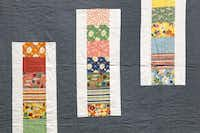 Michelle Kitto of Urban Spools sewing lounge displays some of the modern quilts she and her others have made.(Tom Fox)