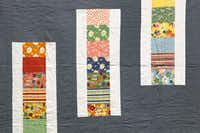 Michelle Kitto of Urban Spools sewing lounge displays some of the modern quilts she and her others have made.Tom Fox