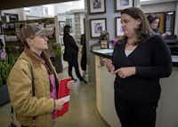 Tonya Miller (left) talks with Amanda Florsheim following her presentation at the Animal Hospital of Rowlett.( Staff photo by G.J. MCCARTHY   - DMN)